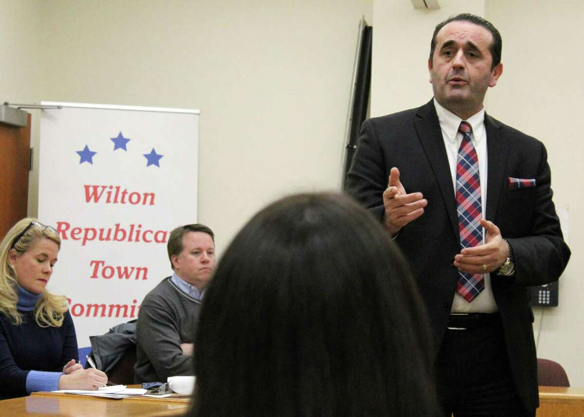 Gubernatorial candidate Peter Lumaj, an immigration attorney from Fairfield, speaks to the Wilton Republican Town Committee Tuesday, Feb. 13, 2018.