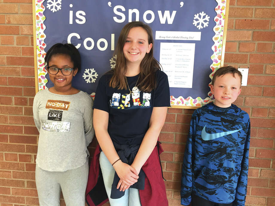 Woodland Elementary  2017-18 Spelling Bee winners are, from left: Kennedy Jackson, second place; Addison Hohlt, first place; and Ian McGinness, third place.  All three will participate in the District 7 Bee which takes place Feb. 22 at 6 p.m. at Lincoln Middle School.  Hohlt will be representing District 7  at the St. Louis Regional competition on March 10 at McKendree University. Photo: Julia Biggs • Jbiggs.edwi@gmail.com