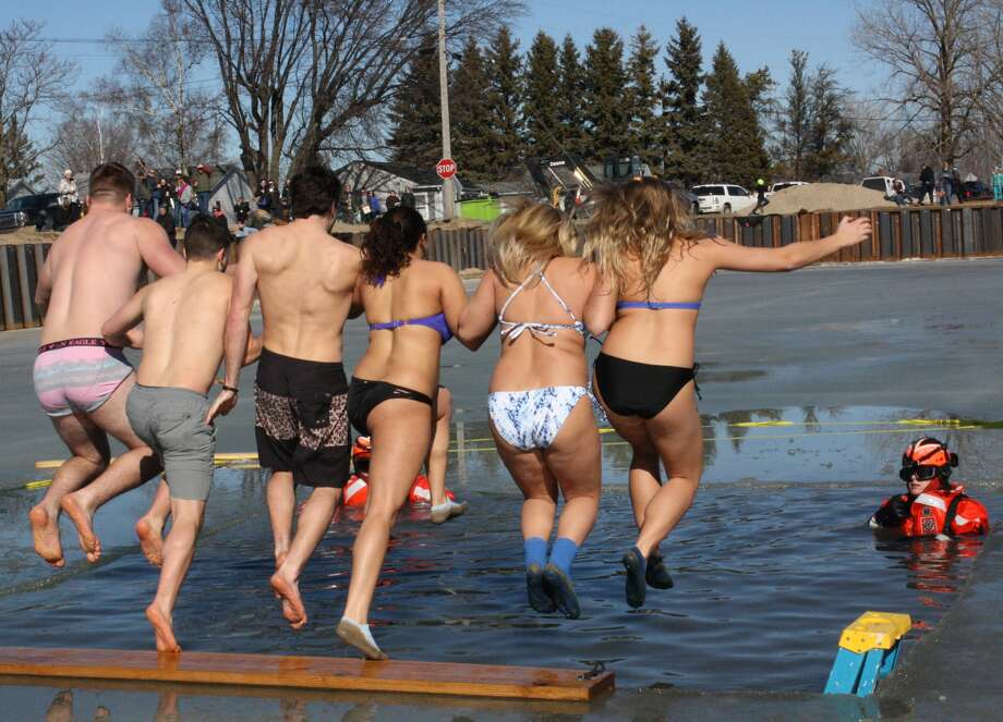 Participants in last year's Polar Dip jump into Lake Huron. Photo: Tribune File Photo