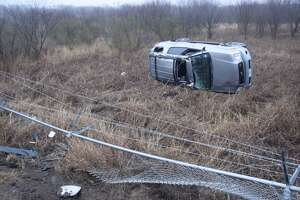 A 26-year-old woman rolled her SUV off Wurzbach Parkway Wednesday morning while en route to pick up her daughter from school.