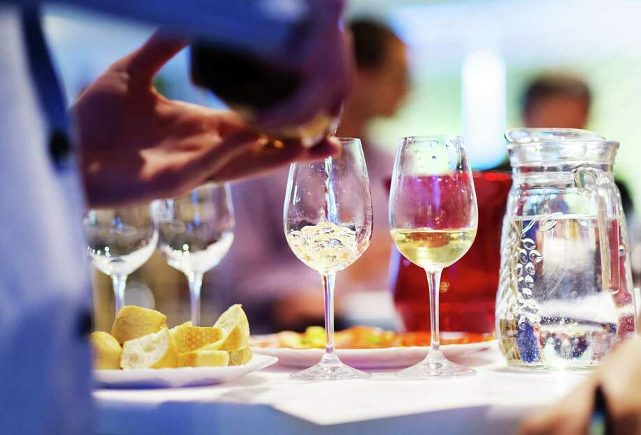 Wine on the Green will featurewine, music, food and fun at the Water Works Park this Saturday. Photo: Courtesy Photo / Halfpoint - Fotolia