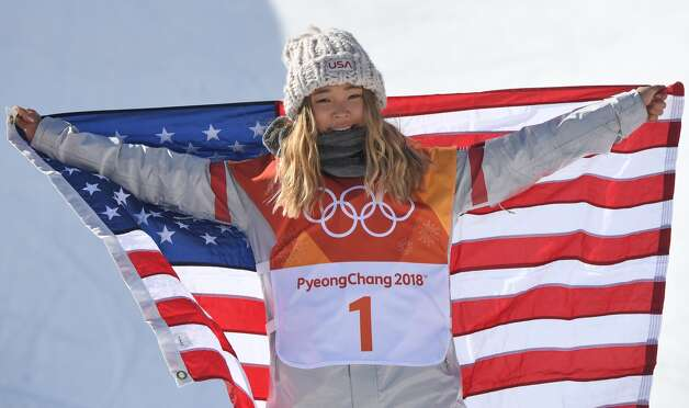 Gold medallist US Chloe Kim celebrates during the victory ceremony after the women's snowboard halfpipe final event at the Phoenix Park during the Pyeongchang 2018 Winter Olympic Games on February 13, 2018 in Pyeongchang. Photo: LOIC VENANCE/AFP/Getty Images