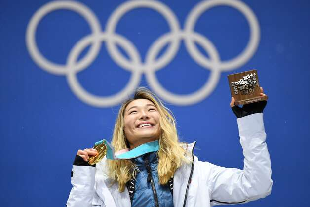 USA's gold medallist Chloe Kim poses on the podium during the medal ceremony for the snowboard women's Halfpipe at the Pyeongchang Medals Plaza during the Pyeongchang 2018 Winter Olympic Games in Pyeongchang on February 13, 2018. Photo: KIRILL KUDRYAVTSEV/AFP/Getty Images