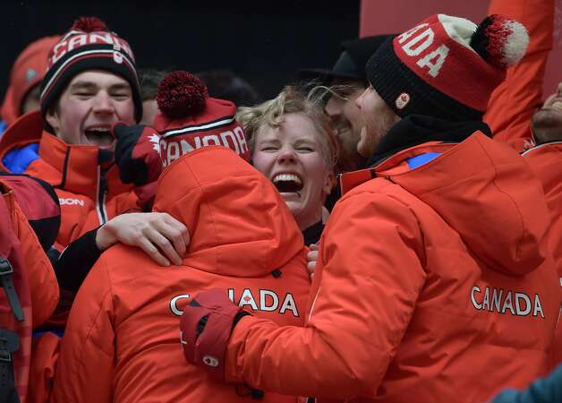 Bronze medallist Canada's Alex Gough (C) celebrates after the women's luge singles during the Pyeongchang 2018 Winter Olympic Games, at the Olympic Sliding Centre on February 13, 2018 in Pyeongchang. Photo: MOHD RASFAN/AFP/Getty Images