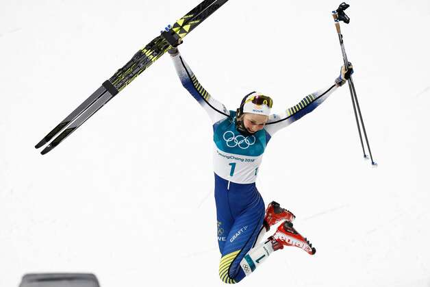 Gold medalist Sweden's Stina Nilsson reacts on the podium during the victory ceremony in the women's cross-country individual sprint classic final at the Alpensia cross country ski centre during the Pyeongchang 2018 Winter Olympic Games on February 13, 2018 in Pyeongchang. Photo: ODD ANDERSEN/AFP/Getty Images