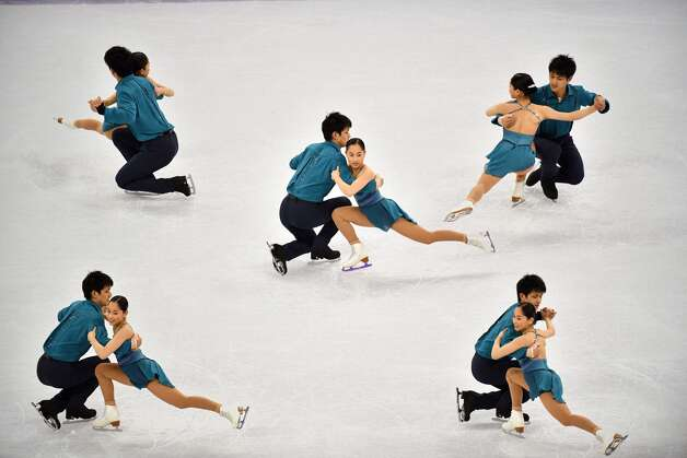 A multiple exposure shows Japan's Miu Suzaki and Japan's Ryuichi Kihara competing in the pair skating short program of the figure skating event during the Pyeongchang 2018 Winter Olympic Games at the Gangneung Ice Arena in Gangneung on February 14, 2018. Photo: MLADEN ANTONOV/AFP/Getty Images