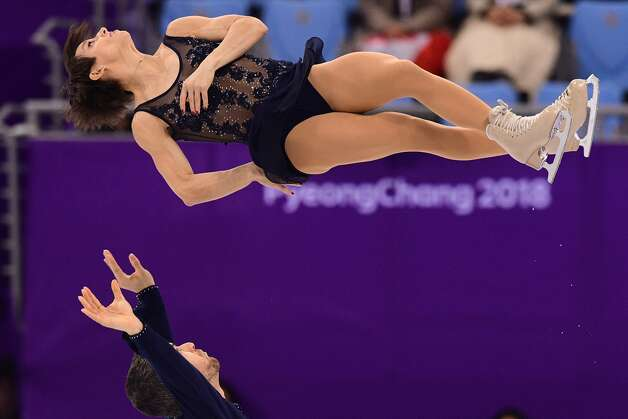Canada's Meagan Duhamel and Canada's Eric Radford compete in the pair skating short program of the figure skating event during the Pyeongchang 2018 Winter Olympic Games at the Gangneung Ice Arena in Gangneung on February 14, 2018. Photo: ROBERTO SCHMIDT/AFP/Getty Images