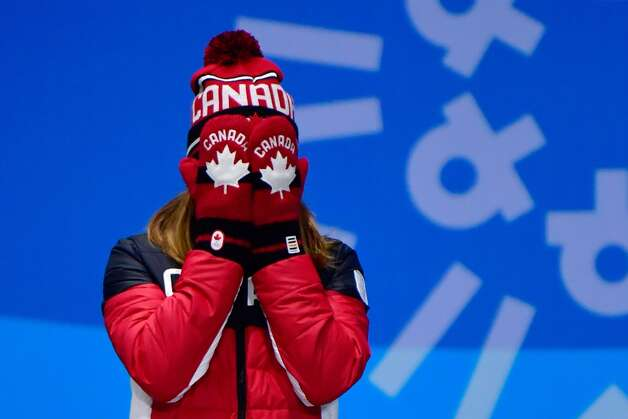 Canada's bronze medallist Kim Boutin cries of joy as she poses on the podium during the medal ceremony for the women's 500m short track at the Pyeongchang Medals Plaza during the Pyeongchang 2018 Winter Olympic Games in Pyeongchang on February 14, 2018. Photo: MARTIN BUREAU/AFP/Getty Images