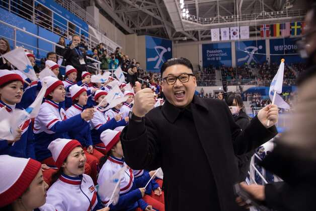 A man impersonating North Korean leader Kim Jong Un gestures as he stands before North Korean cheerleaders attending the Unified Korean ice hockey game against Japan during the Pyeongchang 2018 Winter Olympic Games at the Kwandong Hockey Centre in Gangneung on February 14, 2018. Photo: YELIM LEE/AFP/Getty Images