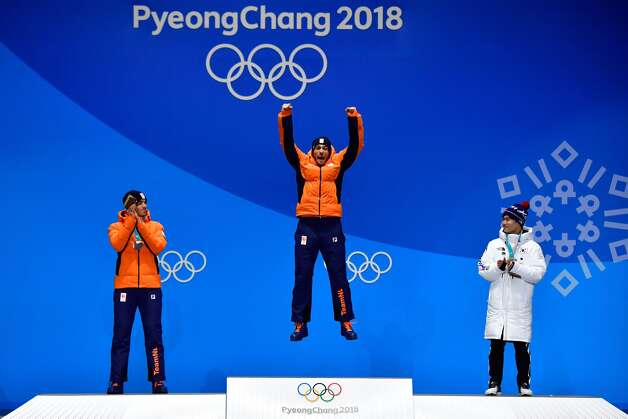 (L-R) Netherlands' silver medallist Patrick Roest, Netherlands' gold medallist Kjeld Nuis and South Korea's bronze medallist Kim Min Seok pose on the podium during the medal ceremony for the men's 1500m speed skating at the Pyeongchang Medals Plaza during the Pyeongchang 2018 Winter Olympic Games in Pyeongchang on February 14, 2018. Photo: MARTIN BUREAU/AFP/Getty Images