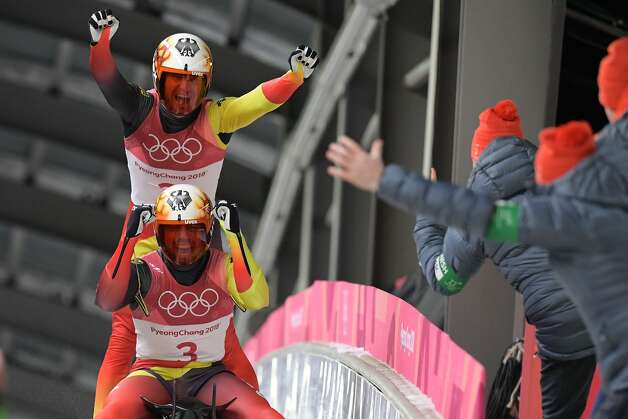 Germany's Tobias Wendl and Tobias Arlt celebrate after winning the doubles luge final event during the Pyeongchang 2018 Winter Olympic Games at the Olympic Sliding Centre on February 14, 2018 in Pyeongchang. Photo: MOHD RASFAN/AFP/Getty Images