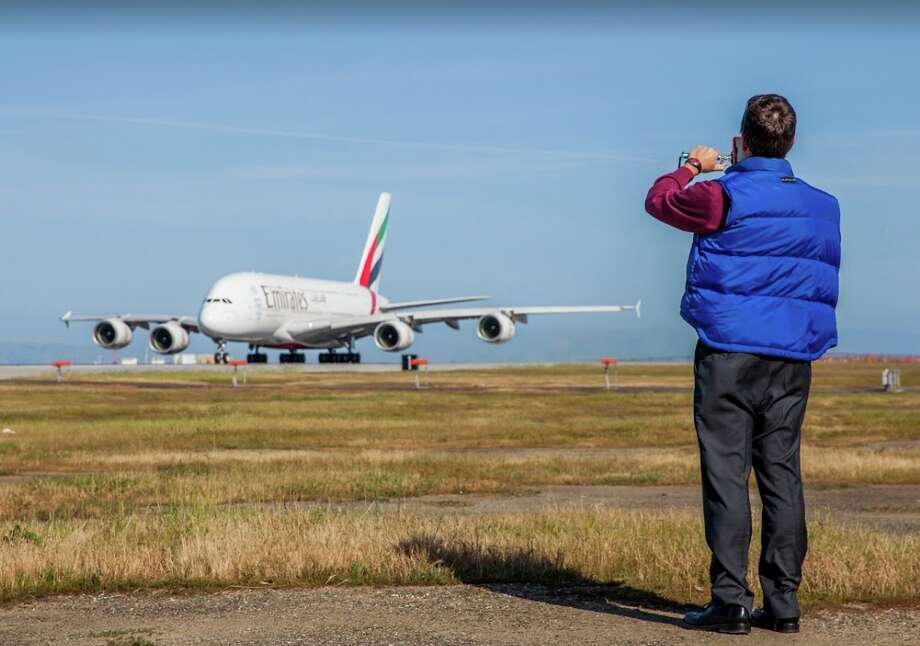 Chris McGinnis getting up close and personal with an Emirates A380 on its maiden voyage to SFO in 2014. Photo: Peter Biaggi