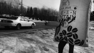GREENMOUNTAIN COFFEE-A one pound bag of coffee trys to thumb a ride on route 7 during the grand opening festivities that last all week at the new digs of the Greenmountain Coffee store on Rt.,7. 3/2/1994. -1- McBride.