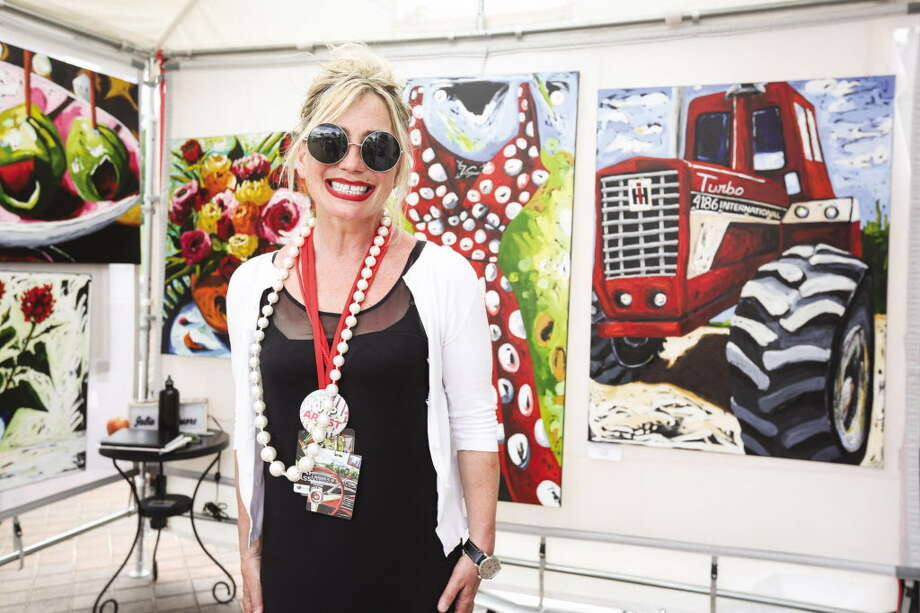 Featured artist Julia Gilmore poses with her work on Sunday, April 10, 2016, at the Woodlands Waterway Arts Festival. This year's festival is set for April 7-8. Photo: Michael Minasi, Photographer / Conroe Courier