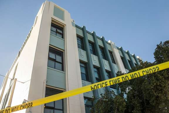 Caution tape surrounds James Lick Middle School after at least ten students were sickened after ingesting an unknown substance Tuesday, Feb. 13, 2018 in San Francisco, Calif.