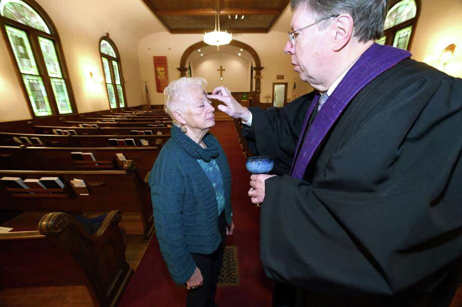 Gerry Borgerson of Branford eceives ashes from Rev. Vance Taylor at North Branford Congregational Church during the Ash on Your Dash! event for Ash Wednesday on February 14, 2018. Photo: Arnold Gold / Hearst Connecticut Media / New Haven Register