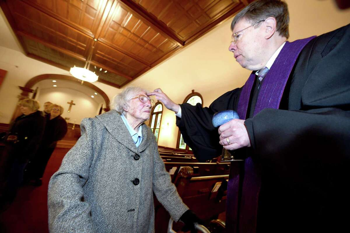 Luella Eastwood, 98, of North Branford receives ashes from Rev. Vance Taylor at North Branford Congregational Church during the Ash on Your Dash! event for Ash Wednesday on February 14, 2018.