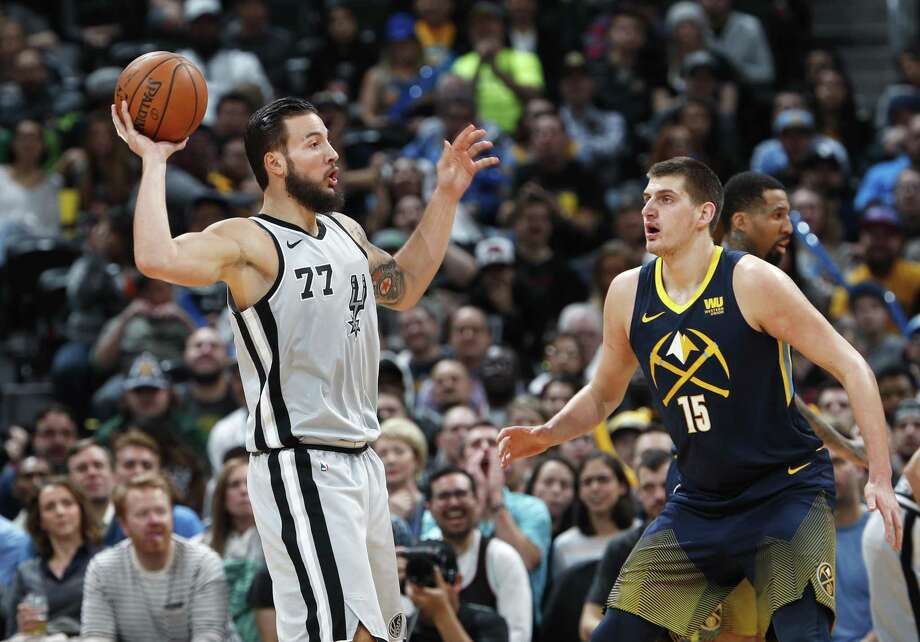 San Antonio Spurs center Joffrey Lauvergne, left, looks to pass the ball as Denver Nuggets center Nikola Jokic defends during the first half of an NBA basketball game Tuesday, Feb. 13, 2018, in Denver. (AP Photo/David Zalubowski) Photo: David Zalubowski, STF / Associated Press / Copyright 2018 The Associated Press. All rights reserved.