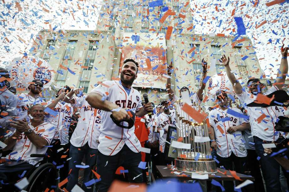 Star second baseman Jose Altuve joyfully tosses a World Series cap into the crowd in front of City Hall during the celebration honoring the Astros and their world championship. Confetti rained over the team – and Gov. Greg Abbott, appropriately attired in an Astros jersey – and for a moment obscured the trophy that eluded the organization since becoming a major league team in 1962. ( Brett Coomer / Houston Chronicle ) Photo: Brett Coomer, Staff / Houston Chronicle / © 2017 Houston Chronicle