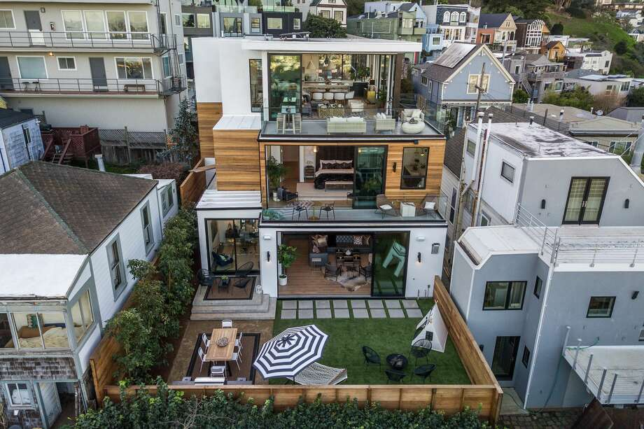 "A brand-new modern masterpiece at 1783 Noe St. in Laidley Heights in San Francisco is listed for $7.7 million. With floor-to-ceiling windows offering sweeping city views, the home is known as ""Noe Looking Glass."" Photo: Real SF Properties"
