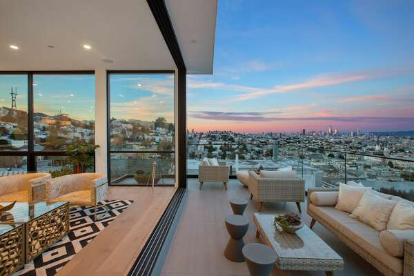 "A brand-new modern masterpiece at 1783 Noe St. in Laidley Heights in San Francisco is listed for $7.7 million. With floor-to-ceiling windows offering sweeping city views, the home is known as ""Noe Looking Glass."""