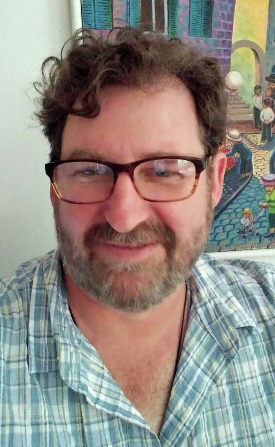 "Brian Clements, a Newtown resident and writing professor at Western Connecticut State University in Danbury, is one of three editors for a book of poetry responding to gun violence, ""Bullets into Bells."" His wife, a teacher, survived the shootings at Sandy Hook Elementary School in Newtown five years ago. Photo: Contributed Photo / Connecticut Post contributed"