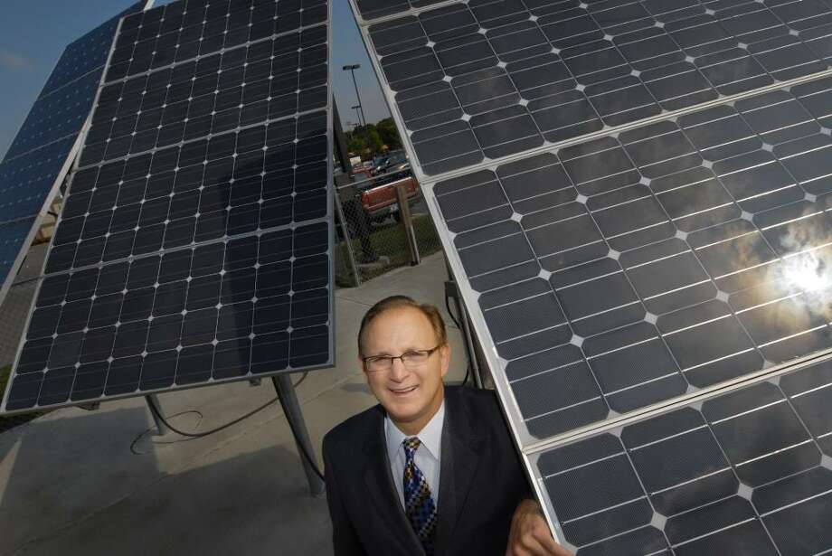 Hudson Valley Community College President Drew Matonak in front of some of the Troy school's solar panels. (Michael P. Farrell / Times Union) Photo: MICHAEL P. FARRELL / 00005573A