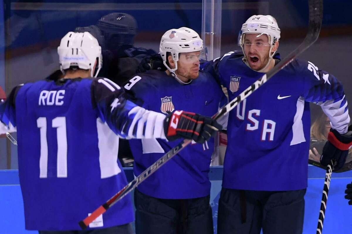 GANGNEUNG, SOUTH KOREA - FEBRUARY 14: Brian O'Neill #9 of the United States celebrates with teammates Jonathon Blum and Garrett Roe #11 after scoring a goal on Gasper Kroselj #32 of Slovenia in the first period during the Men's Ice Hockey Preliminary Round Group B game on day five of the PyeongChang 2018 Winter Olympics at Kwandong Hockey Centre on February 14, 2018 in Gangneung, South Korea. (Photo by Harry How/Getty Images)
