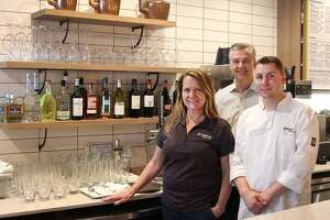 Owner Andrea Gartner, consultant Mark Moeller and chef Matt Rieve in the Pour Me cafe on Main Street in Danbury.