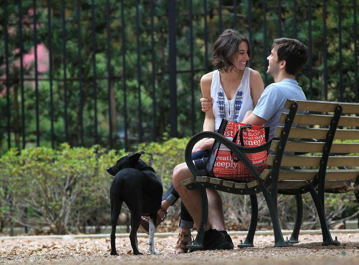 Tali Pinckney, 25, and her boyfriend of four years, Andrew St. Onge sit on a bench in Hermann Park Sunday, Feb. 14, 2016, in Houston. ( Jon Shapley / Houston Chronicle )Valentines Day