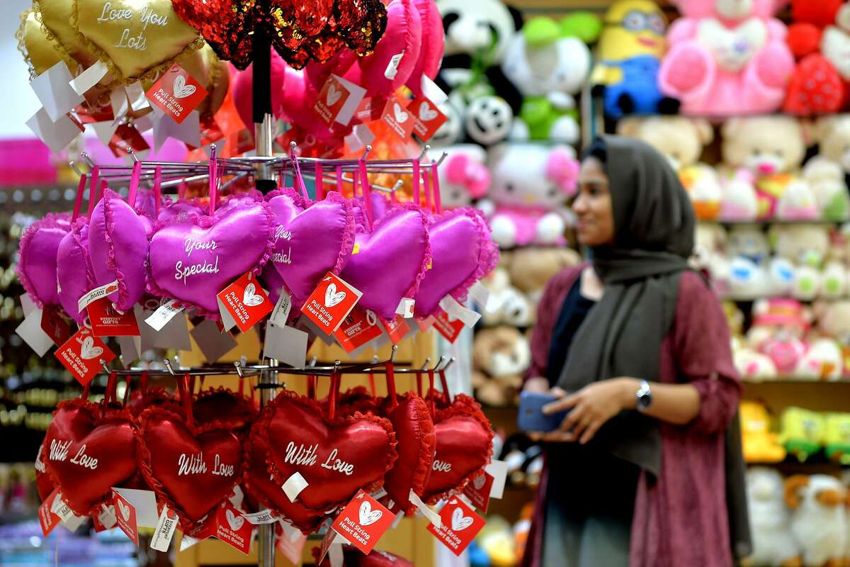 A customer looks at Valentines Day gifts items in a store for the forthcoming Valentines Day celebrations in Bangalore on February 12, 2018. / AFP PHOTO / MANJUNATH KIRANMANJUNATH KIRAN/AFP/Getty Images