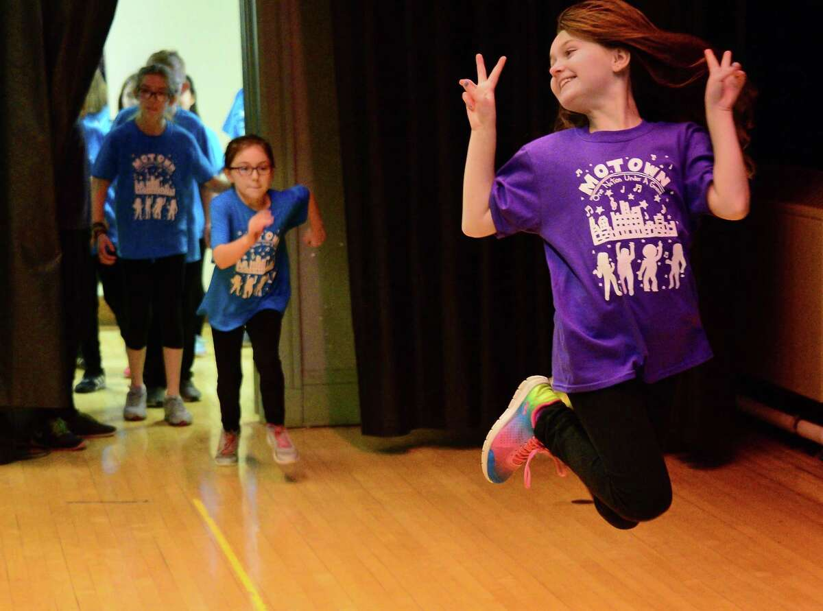 Kayli Jenkins, right, of Wood Road Elementary makes her entrance onstage as students rehearse for their SPAC Dance Residency performance at Malta Avenue Elementary School Wednesday Feb. 14, 2018 in Ballston Spa, NY. (John Carl D'Annibale/Times Union)
