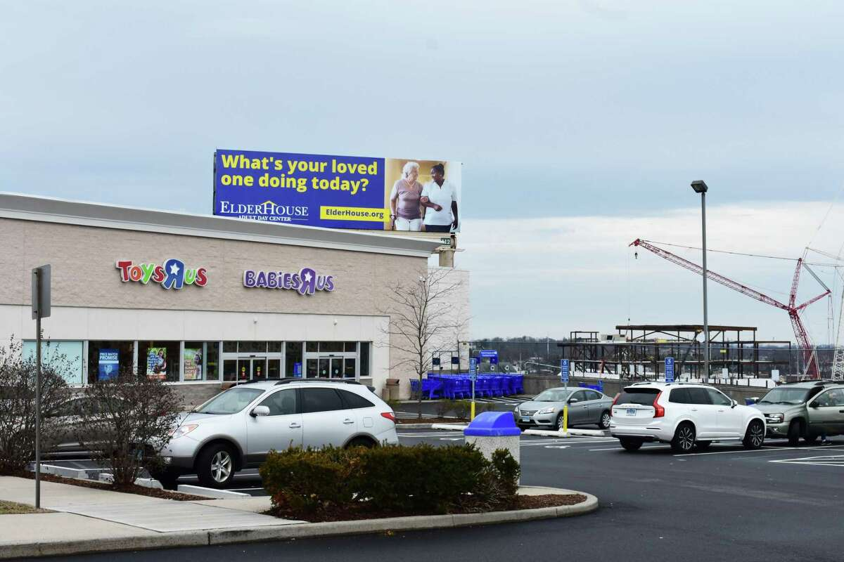 The Toys R Us store at 59 Connecticut Ave. in Norwalk, Conn., with the SoNo Collection mall under construction on West Avenue in the background. In February 2018, the Norwalk Redevelopment Agency is proposing extending a redevelopment zone covering West Avenue to include the Toys R Us building, against the chance the store eventually closes after Toys R Us completes a bankruptcy restructuring.