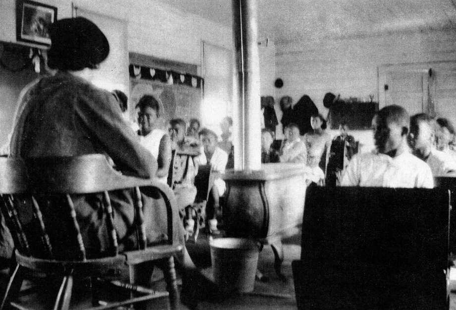 The La Porte Colored School, shown here with teacher Viola DeWalt and her students, served black students in the community for more than 40 years. The building has been reconstructed.