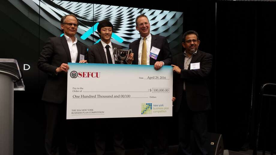 Timothy Oh being presented with the $100,000 award at the New York Business Plan Competition in 2016 at SUNY Polytechnic Institute. Oh's company, Vara Firearm Security, was known as Dual:Lock at the time. Photo: SUNY Poly