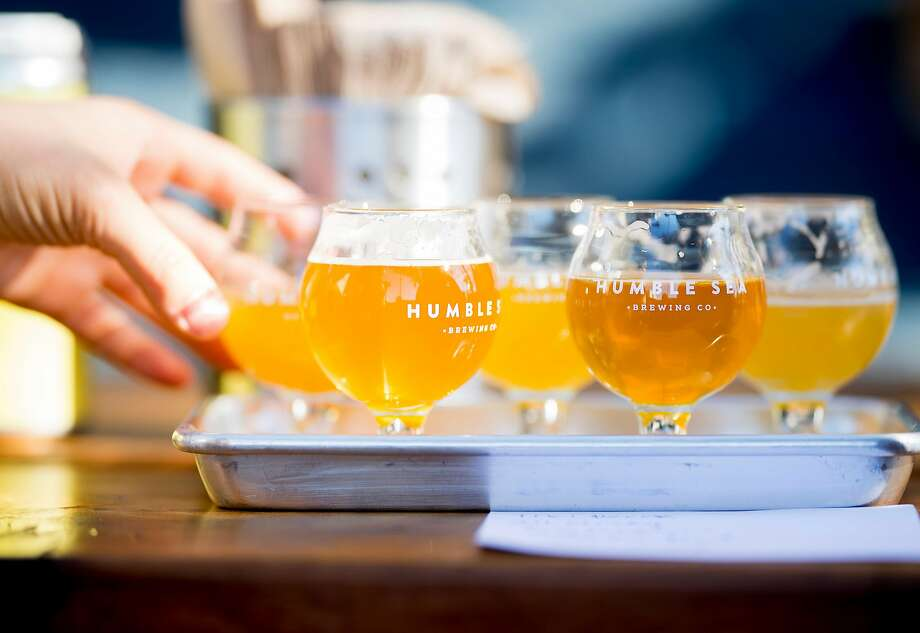 A patron samples beer at Humble Sea Brewing Company in Santa Cruz, Calif., on Saturday, Nov. 18, 2017. Photo: Noah Berger, Special To The Chronicle