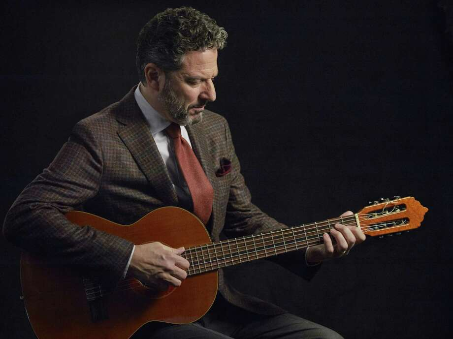 Guitarist John Pizzarelli will perform at Greenwich Library Feb. 18. Photo: Contributed Photo