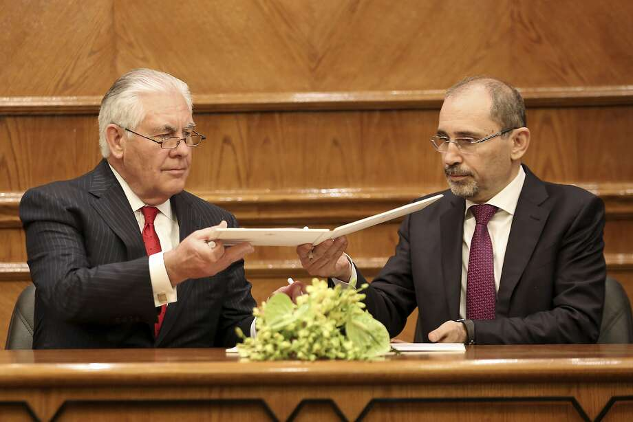 Secretary of State Rex Tillerson (left) sign agreements with Jordan's Foreign Minister Ayman Safadi, in Amman, to increase U.S. aid by more than $1 billion over the next five years. Photo: Raad Adayleh, Associated Press