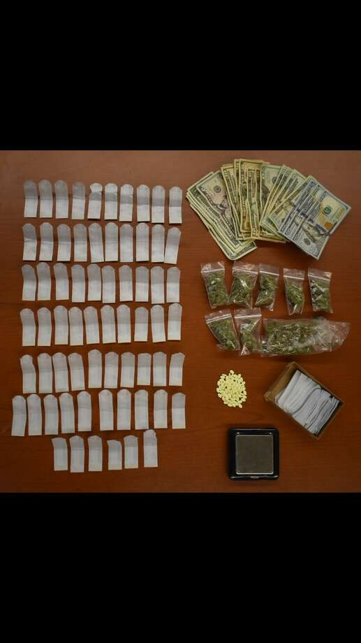 Albany County Sheriff's investigators seized 66 glassine bags containing heroin, 83 Xanax pills, a quantity of marijuana, $2,555 in cash, along with packaging material and a digital scale used for the distribution of heroin at a residence in Troy in February 2018. Photo: Albany County Sheriff's Office