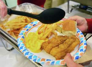 St. Edward's Church hosts its annual Ash Wednesday Fish Fry Dinner , a full meal consisting of a piece of fish, French fries, macaroni and cheese, coleslaw, bread, soft drinks, coffee, and desert Feb. 14, 2018 in Clifton Park, NY.  (John Carl D'Annibale/Times Union)