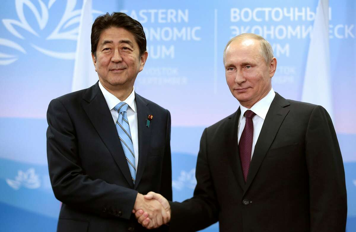 Vladimir Putin (right) and Shinzo Abe have talked about ending a long-standing territorial dispute.