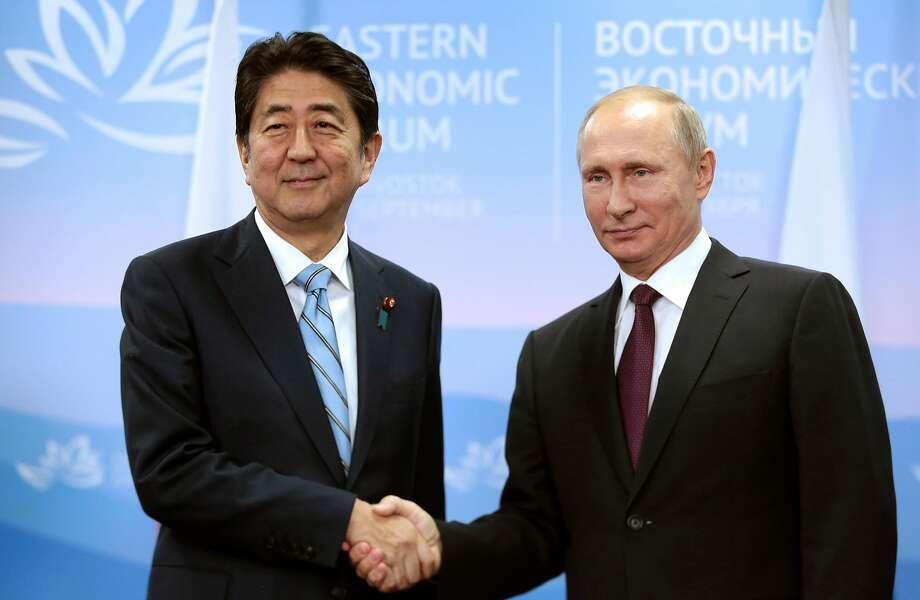 Vladimir Putin (right) and Shinzo Abe have talked about ending a long-standing territorial dispute. Photo: Mikhail Metzel, AP