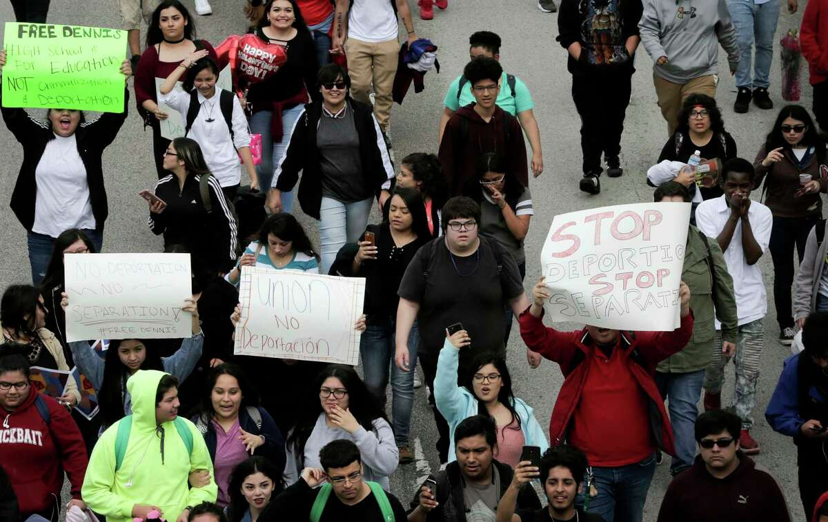 Austin High School students walk down Jefferson Street in protest the ICE detention of Dennis Rivera, a student from their school on Wednesday, Feb. 14, 2018, in Houston.