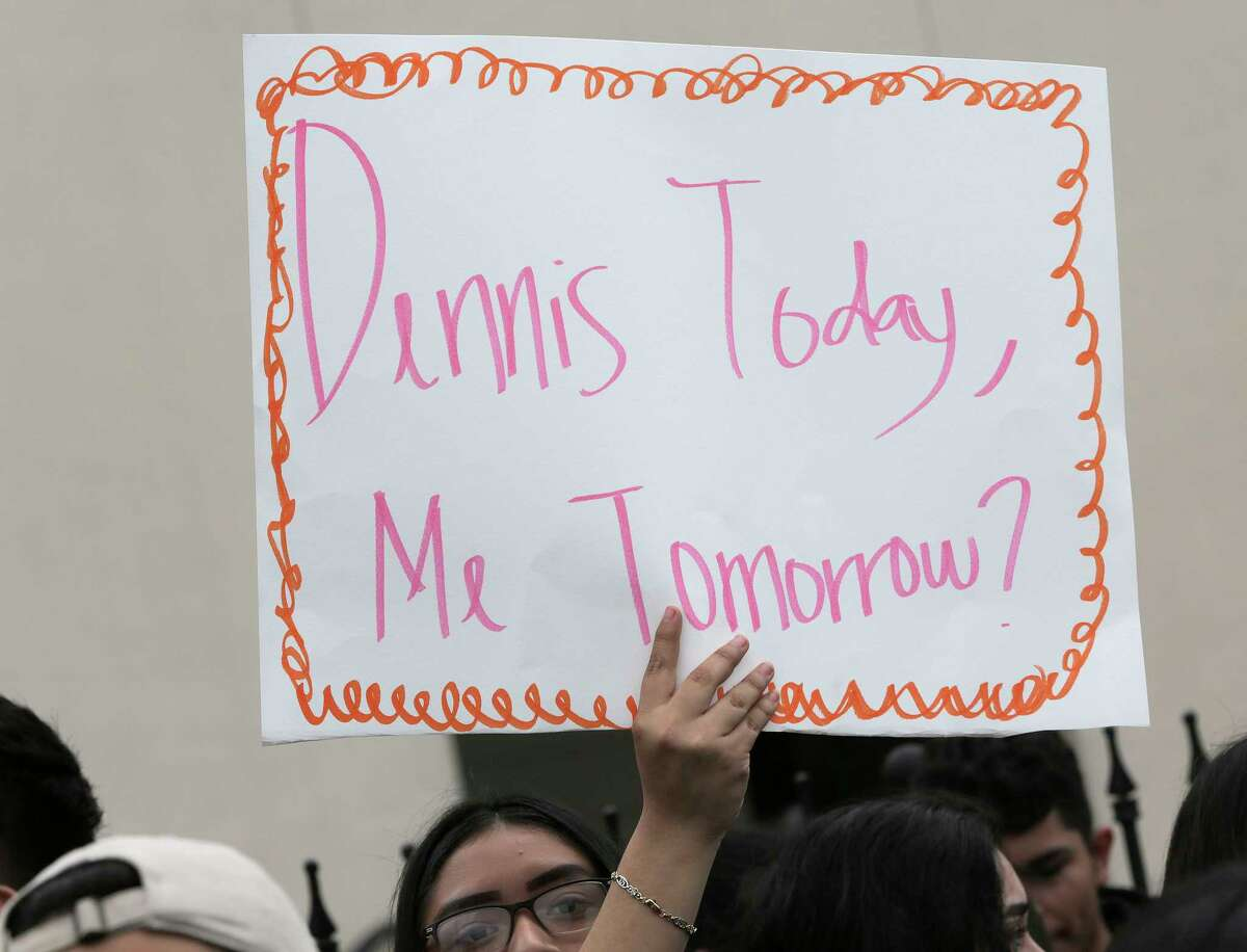 An Austin High School student holds a sign in protest the ICE detention of Dennis Rivera, a student from their school on Wednesday, Feb. 14, 2018, in Houston.
