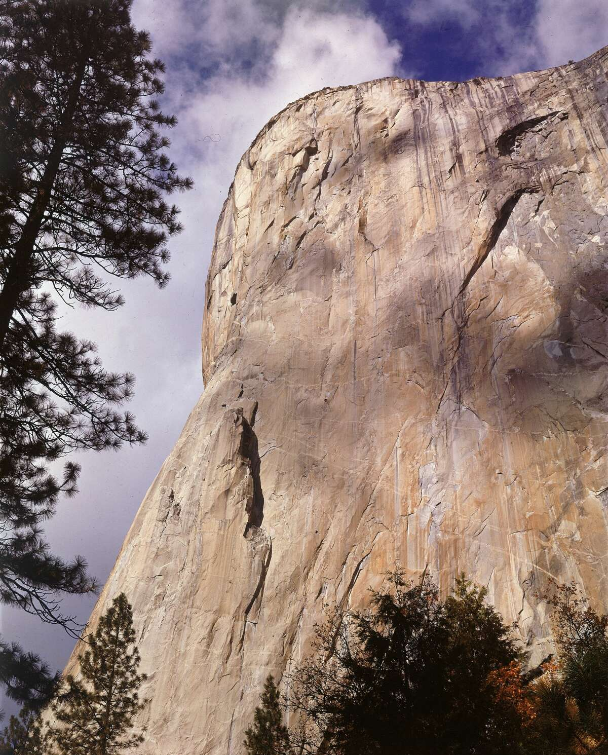 Dean Caldwell and Warren Harding appear as specks on the face of Half Dome in Yosemite National Park.
