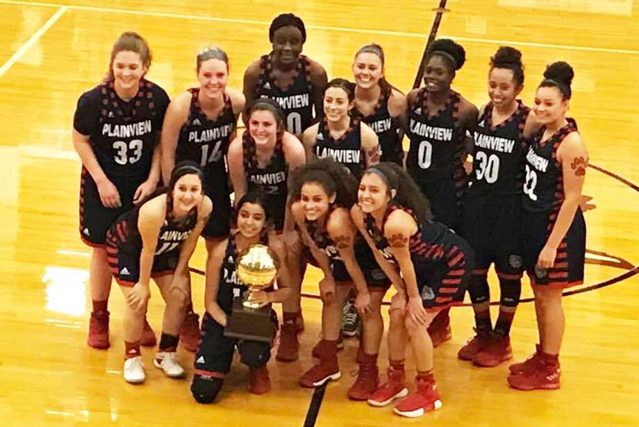The Plainview girls' basketball team poses with the bi-district championship trophy at Littlefield High School Tuesday night shortly after they dominated Lubbock Monterey, 62-30, to claim the title. The Lady Bulldogs will play an area round game at 6 p.m. Friday against El Paso Andress. The contest will be in Monahans. Photo: Courtesy Photo
