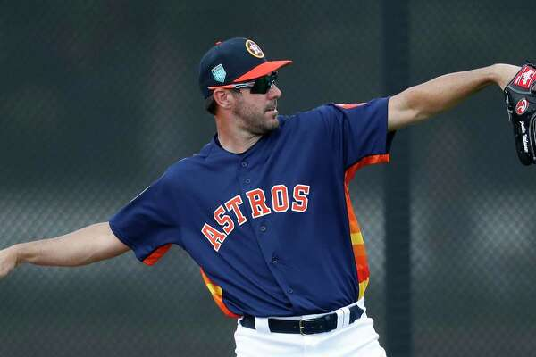 Houston Astros pitcher Justin Verlander (35) works a throwing program as the pitchers and catchers worked out for the first time during spring training at The Ballpark of the Palm Beaches, Wednesday, Feb. 14, 2018, in West Palm Beach .