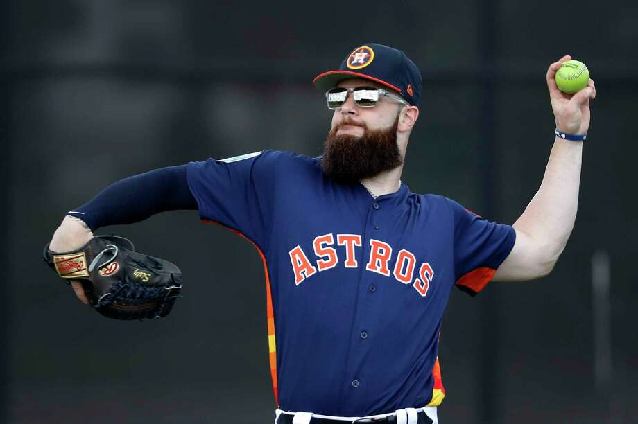 Houston Astros pitcher Dallas Keuchel (60) works with a green ball during a throwing program as the pitchers and catchers worked out for the first time during spring training at The Ballpark of the Palm Beaches, Wednesday, Feb. 14, 2018, in West Palm Beach . Photo: Karen Warren, Houston Chronicle / © 2018 Houston Chronicle