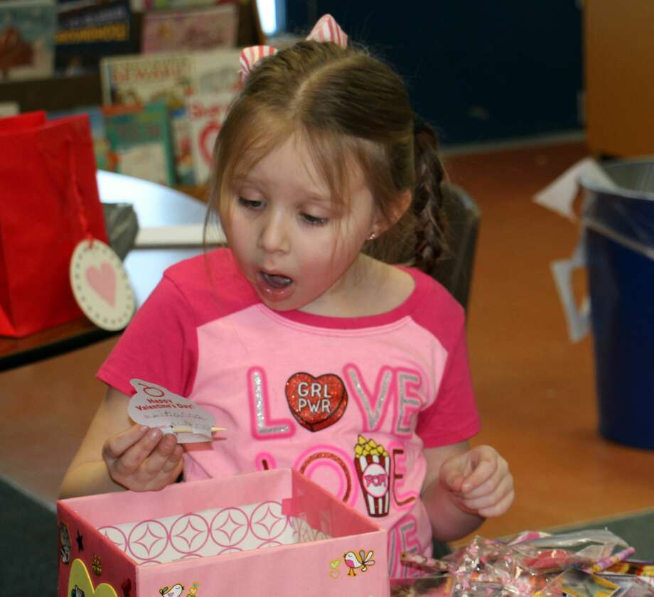 p.p1 {margin: 0.0px 0.0px 0.0px 0.0px; font: 12.0px Helvetica}Bad Axe Elementary first-grader Lihanna Howells was in shock as she went through her Valentine's Day box on Wednesday. Howells said she was very happy with everything she received from her fellow classmates — especially the candy. Photo: Bradley Massman/Huron Daily Tribune