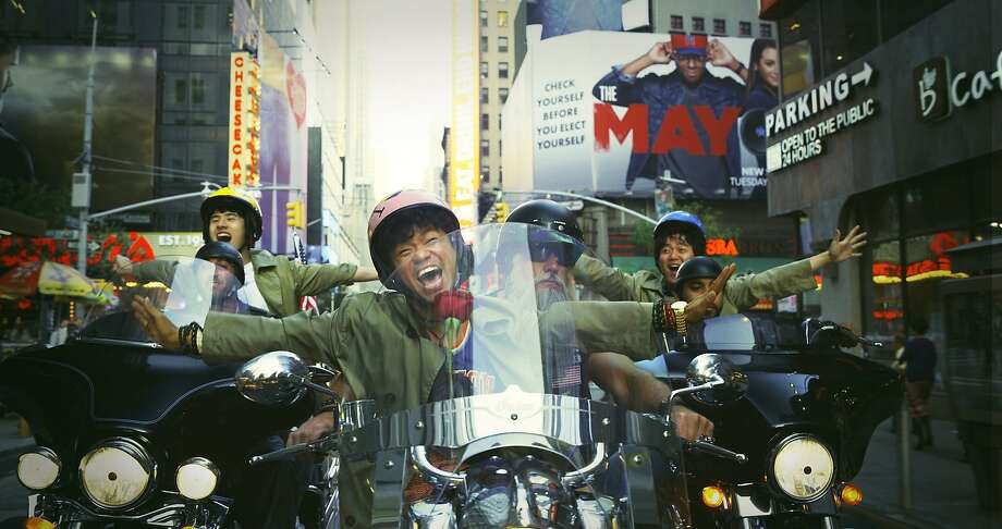 "Liu Haoran (left rear) and Wang Baoqiang (center) and reprise their roles in ""Detective Chinatown 2."" Photo: Warner Bros."
